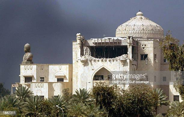 The front of Iraqi President Saddam Hussein's largest palace shows damage after aerial bombing March 23 2003 in Baghdad Iraq Iraq claims that 350 of...