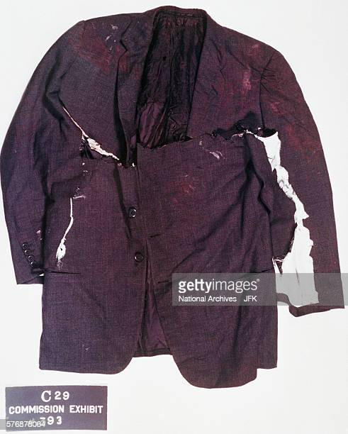 The front of the jacket worn by President Kennedy on day of his assassination It was cut in the hospital A bullet hole is visible on the right...