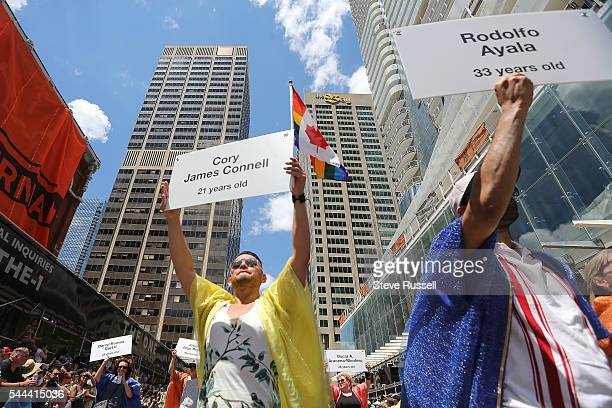 TORONTO ON JULY 3 The front of the parade included marchers carrying signs dedicated to the 49 victims of the Pulse nightclub Shooting in Orlando...
