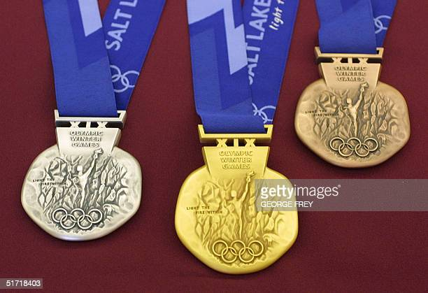 The front of the silver gold and bronze medals for the Salt Lake City 2002 Winter Olympics are displayed at an unveiling ceremony 15 October 2001 in...