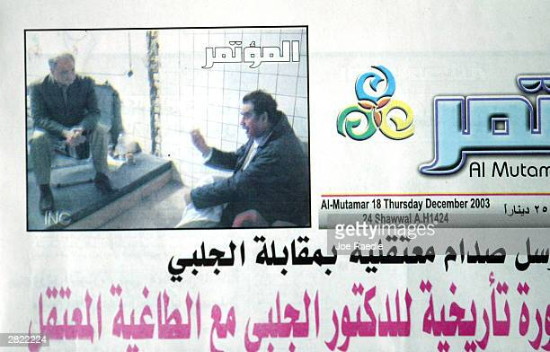 The front page of Al Mutamar newspaper published December 18 2003 in Baghdad shows a picture of Saddam Hussein talking with Ahmed Chalabi a member of...