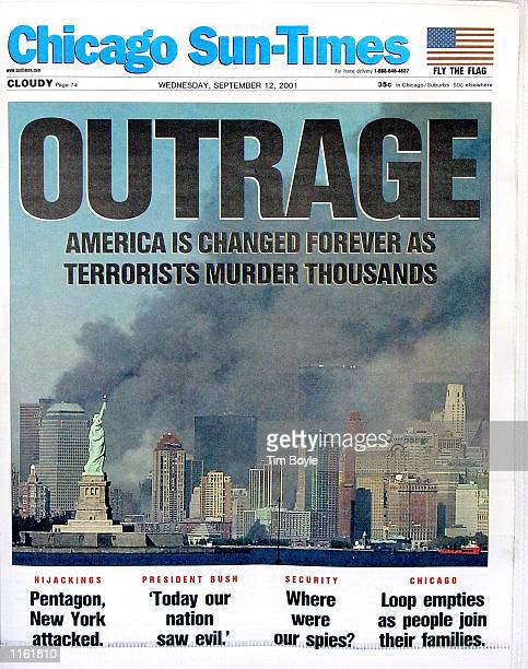 "The front page of the Chicago Sun-Times with a headline that reads ""OUTRAGE"" regarding the terrorist attack on New York City's World Trade Center is..."