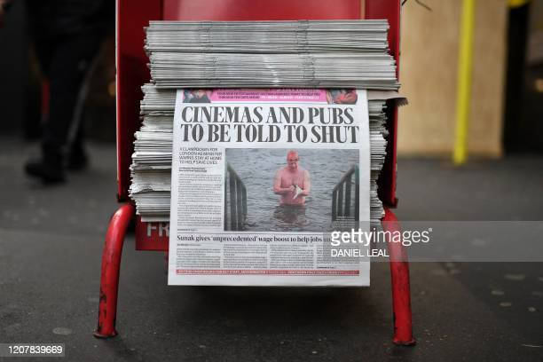 The front page of the Evening Standard newspaper, leading with the story that UK cinemas and pubs are likely to be ordered close later today, is...