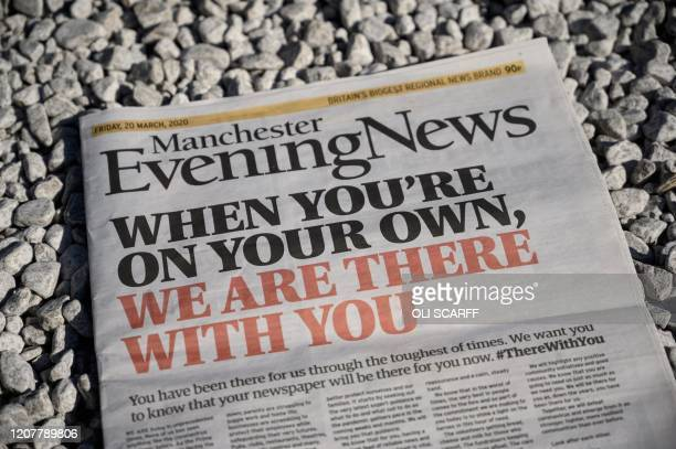 The front page of the Manchester Evening News which features the same headline as numerous local and regional newspapers across the UK in a...