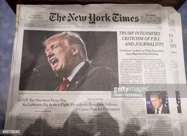 The front page of the New York Times carries a picture of President Donald Trump February 25 2017 a day after he criticized in a speech the FBI and...