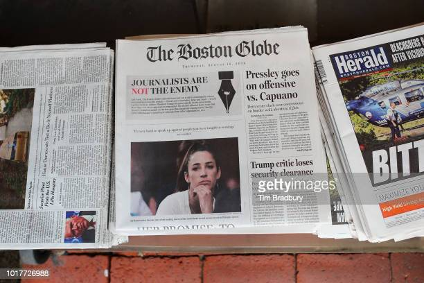 The front page of the Thursday August 16 2018 edition of the Boston Globe newspaper reads 'Journalists are Not the Enemy' as it sits for sale at Out...