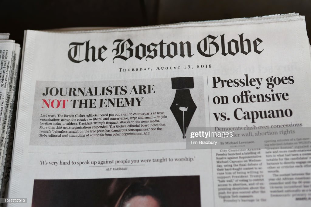 The front page of the Thursday, August 16, 2018 edition of the Boston Globe newspaper reads 'Journalists are Not the Enemy' as it sits for sale at Out of Town News on August 16, 2018 in Cambridge, Massachusetts. Hundreds of U.S. newspapers joined together and published editorials decrying President Donald Trump's description of the media as the 'enemy of the people.'