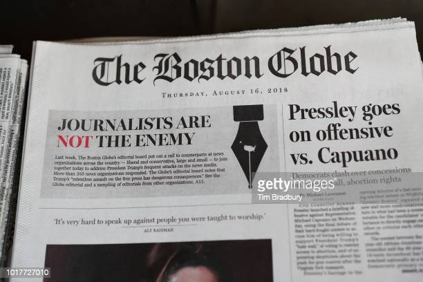 The front page of the Thursday August 16 2018 edition of the Boston Globe newspaper reads Journalists are Not the Enemy as it sits for sale at Out of...
