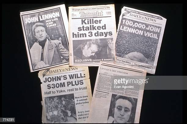 The front pages of several newspapers are on display December 2 1995 in New York City The memorial to John Lennon in Central Park called Strawberry...