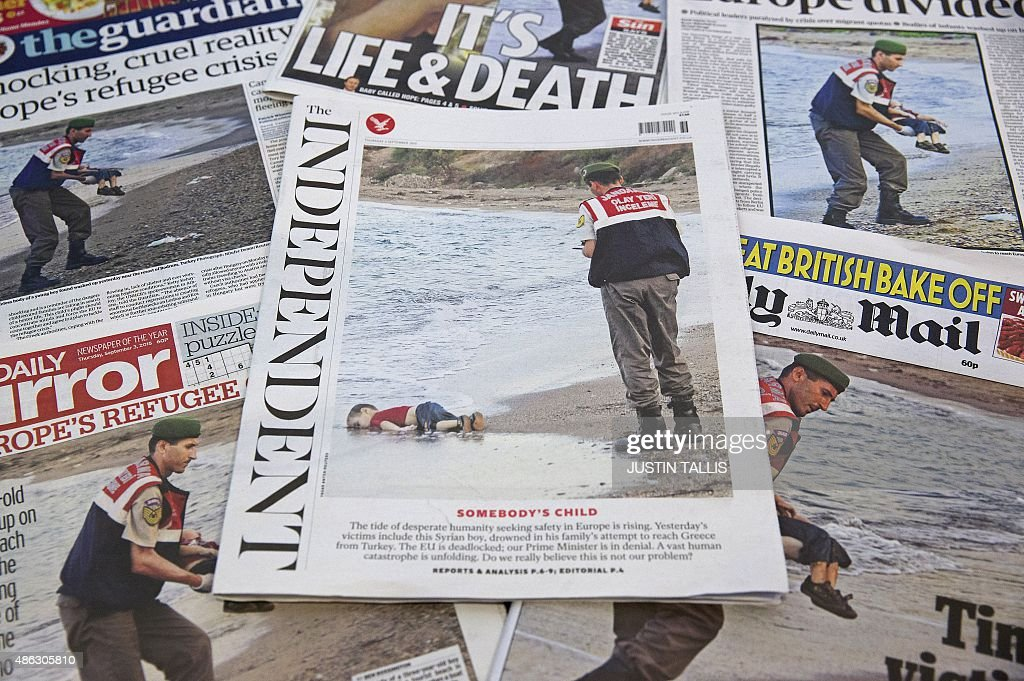 The front pages of some of Britain's daily newspapers showing an image of the body of Syrian three-year-old boy Aylan are pictured in London, on September 3, 2015. The image spread like lightning through social media and dominated front pages from Spain to Sweden, with commentators unanimous it had rammed home the horrors faced by those fleeing war and conflict in the Middle East and Africa.