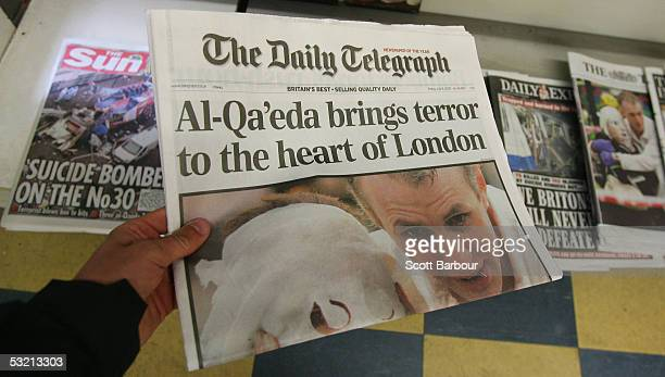 The front pages of the British national newspapers bearing the news of the London bomb attacks are displayed at a newsagents on July 8 2005 in London...