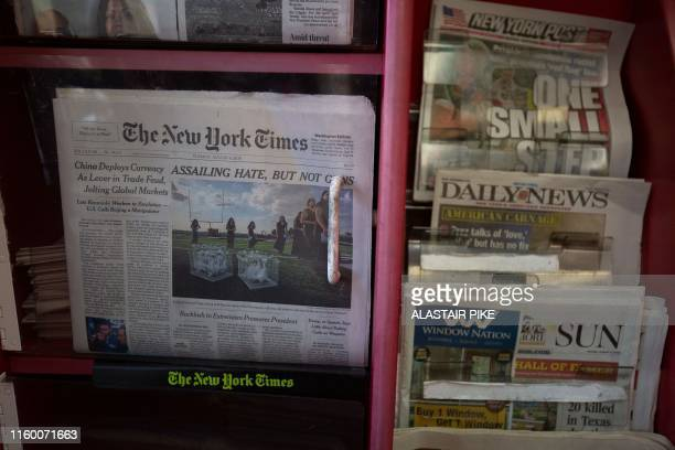 The front pages of The New York Times, New York Post, New York Daily News and Baltimore Sun newspapers are seen at a convenience store in Washington,...