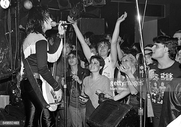 The front rows of the audience cheering as American singer-songwriter and guitarist Joan Jett performs on stage at a club in New York, 1981.