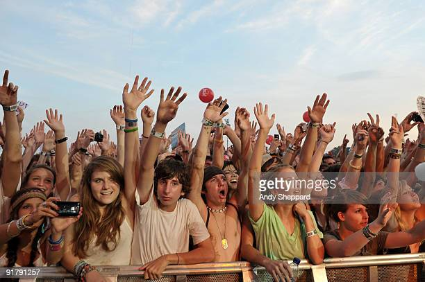 The front rows of the crowd showing audience members cheering, raising their arms and looking up at the stage on Day 3 of Austin City Limits Festival...