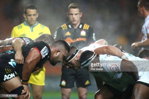 The front rows pack down for a scrum during the round 13 match between the Chiefs and the Sharks at FMG Stadium on May 11, 2019 in Hamilton, New...