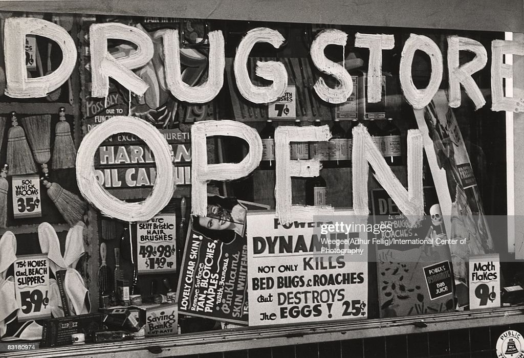 The front window of a drug store in Harlem after the 1943 riots displays a 'Drug Store Open' sign painted on the window. The rioting ensued after a black military policeman was shot by a white police officer. The soldier reportedly tried to steal the officer's night stick while arresting a woman for disorderly conduct. A riot ensued when Harlem residents erroneously thought that the black military officer was killed. In fact, the soldier was merely treated for a minor arm injury at Sydenham Hospital, 1943. (Photo by Weegee(Arthur Fellig)/International Center of Photography/Getty Images)