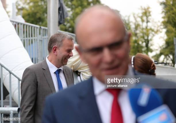 The frontrunner of the party Alternative for Germany LeifErik Holm and the SPD frontrunner State Premier Erwin Sellering walk to the TV studio after...