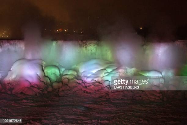 The frozen American Falls are illuminated in Niagara Falls Ontario Canada on January 30 2019 Frostbite warnings were issued for parts of the US...