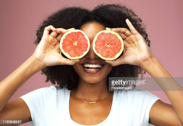 the fruit that cares for your health and beauty - hands covering eyes stock pictures, royalty-free photos & images