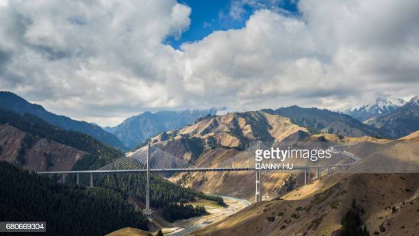 the fruit valley bridge connect mountains in west china - シルクロード ストックフォトと画像