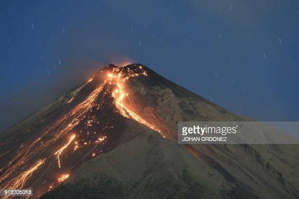 TOPSHOT The Fuego volcano spews ash as seen from the city of Alotenango in Sacatepequez departament 65 km southeast of Guatemala City on February 1...