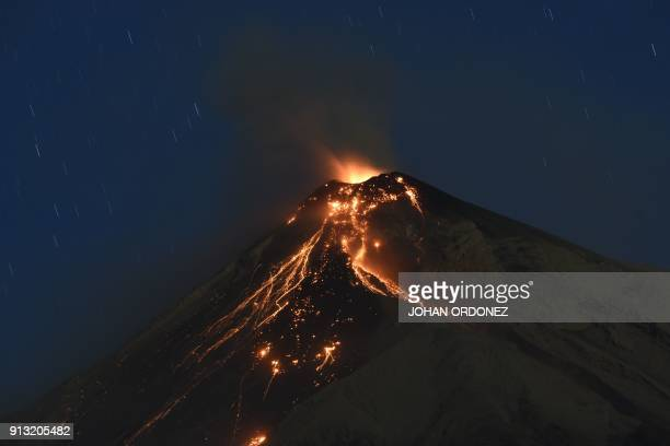 The Fuego volcano spews ash as seen from the city of Alotenango in Sacatepequez departament 65 km southeast of Guatemala City on February 1 2018 The...