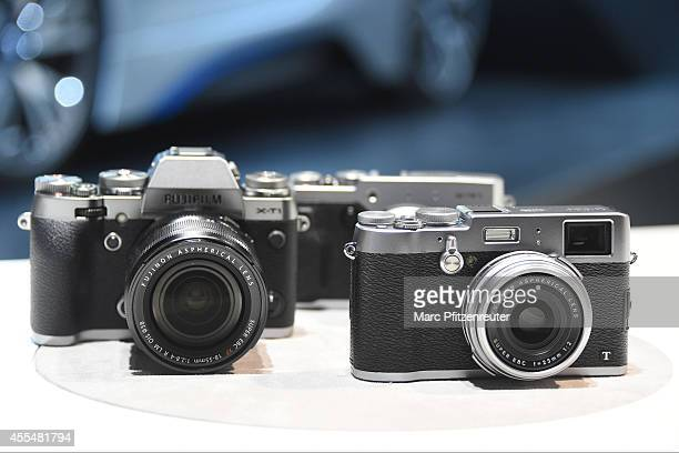 The Fujifilm XT1 and Fujifilm X30 cameras are displayed at the Photokina 2014 trade fair on September 15 2014 in Cologne Germany Photokina is the...