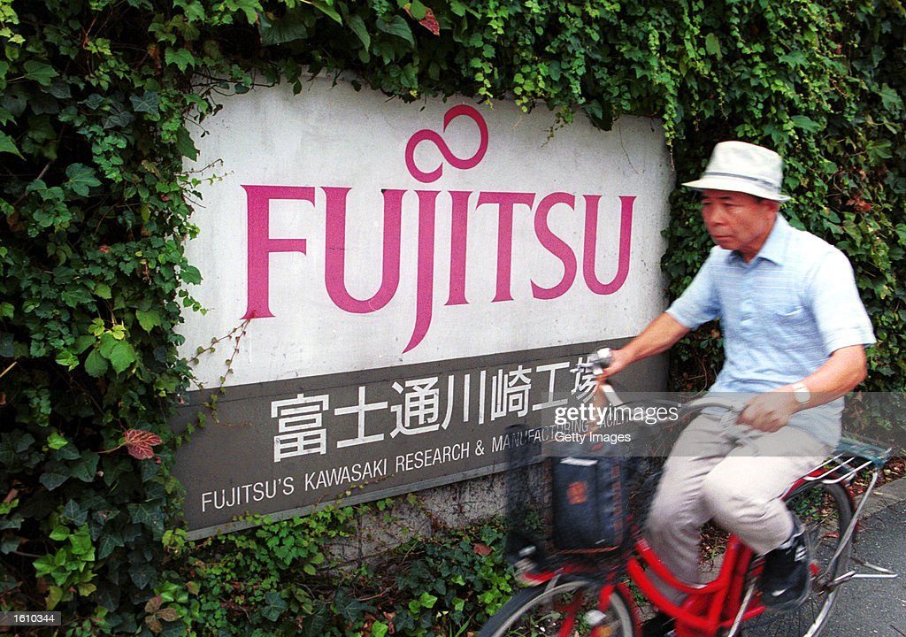 The Fujitsu logo is on display in front of the company''s headquarters for Fujitsu Kawasaki August 24, 2001 in Tokyo, Japan. The company announced a restructuring program to help counter effects from the continued weakness in the global information technology market and said it would eliminate 16,400 jobs.