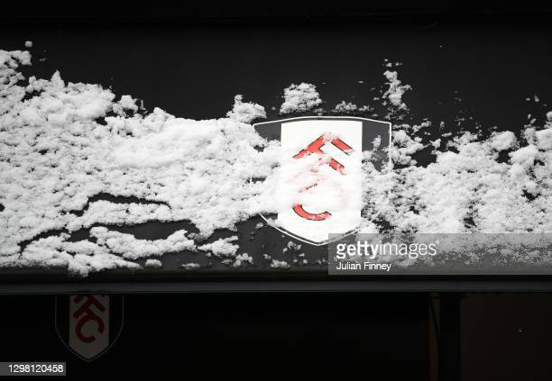 The Fulham crest is seen partly covered in snow prior to The Emirates FA Cup Fourth Round match between Fulham and Burnley at Craven Cottage on...