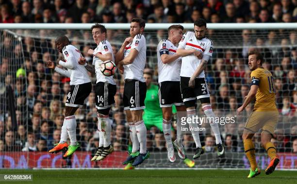 The Fulham defensive wall jump to block a free kick during The Emirates FA Cup Fifth Round match between Fulham and Tottenham Hotspur at Craven...