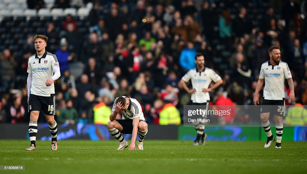 The Fulham players look dejected after conceding a second goal during the Sky Bet Championship match between Fulham and Bristol City at Craven Cottage on March 12, 2016 in London, United Kingdom.