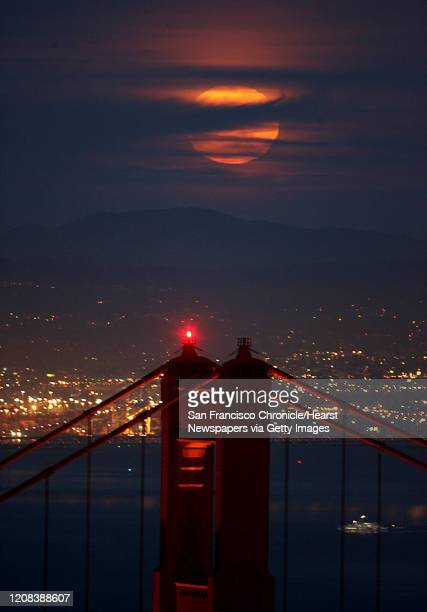 The full April moon made it through the cloud cover and over the north tower of the Golden Gate Bridge seen from Hawk Hill up in the Marin Headlands...