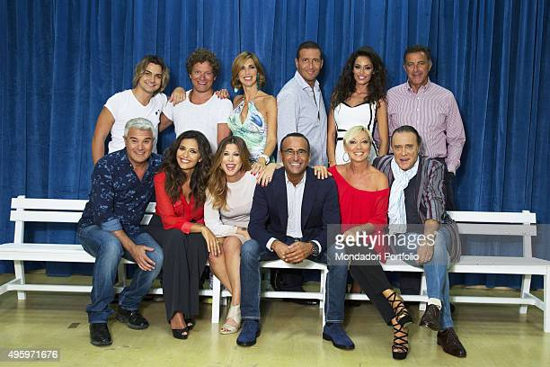 The full cast posing during a photo shoot realized inside the television studio where the talent show 'Tale e quale show' is recorded standing from...