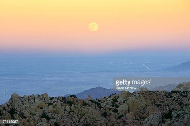 The full Harvest Moon marks the Autumnal Equinox as it rises over a landscape made up entirely of huge rock formations which comprises the remote...
