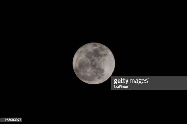 The full Harvest Moon rises as seen in the Cibitung region, Bekasi Regency, West Java Province on September 14, 2019. According to the Indonesian...