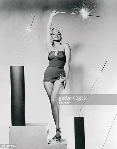 The full impact of this setting becomes apparent as Marilyn the screen star stands triumphant amid flashing sparklers Even that spangle on the hem of...