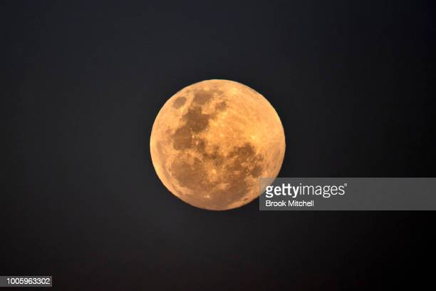 The full moon rises near Bondi Beach ahead of a total lunar eclipse on July 27 2018 in Sydney Australia The period of totality during this eclipse...
