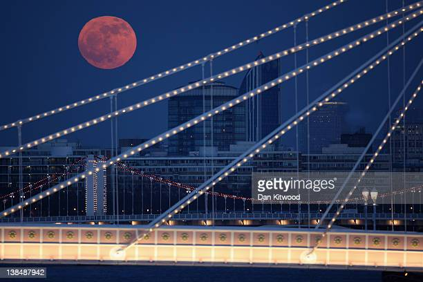The Full moon rises over Albert Bridge on February 7 2012 in London England Albert Bridge is said to be one of the most romantic bridges in London...