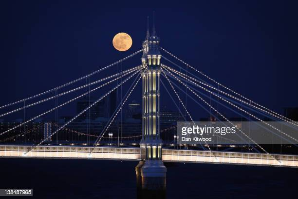 The Full moon rises over Albert Bridge on February 7 2012 in London England Albert Bridge is said to be one of the most romantic bridges in London...