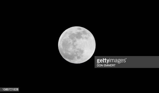 The full Super Moon is seen in the sky over New York on January 21 2019