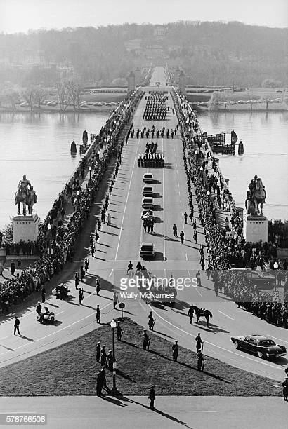 The funeral cortege carrying assassinated President John Fitzgerald Kennedy's casket crosses the Lincoln Memorial Bridge over the Potomac River to...