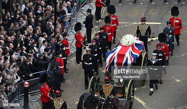 The funeral cortege carrying the body of former Prime Minister Margaret Thatcher passes along Fleet Street on April 17 2013 in London England...