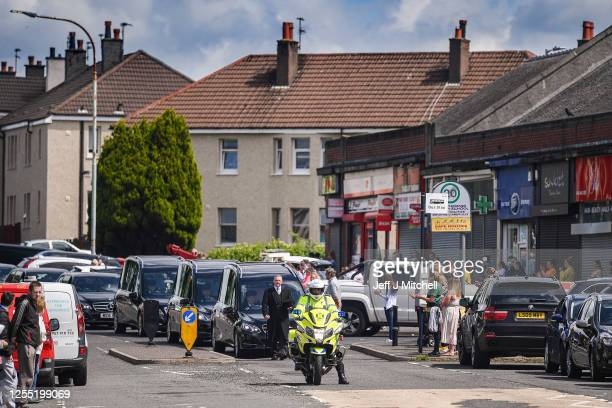 The funeral cortege for Fiona Gibson Alexander James Gibson eight and fiveyearold Philip Gibson makes its way through the Gallowhill streets on July...