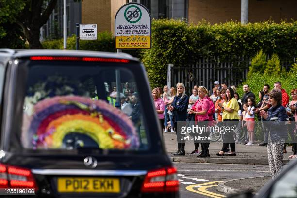The funeral cortege for Fiona Gibson twelve Alexander James Gibson eight and fiveyearold Philip Gibson makes its way through the streets on July 9...