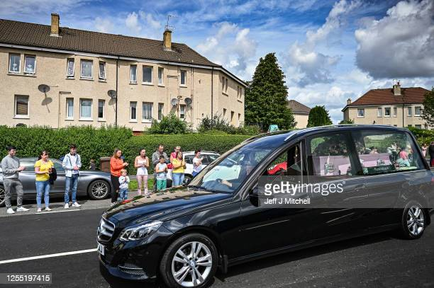 The funeral cortege for Fiona Gibson twelve Alexander James Gibson eight and fiveyearold Philip Gibson makes its way through the streets of...