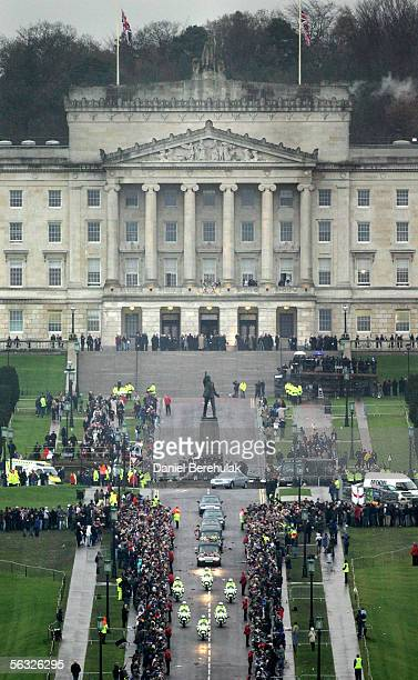 The funeral cortege for footballer George Best makes its way from the service at Stormont Parliament buildings Great Hall to Roselawn Cemetery in...