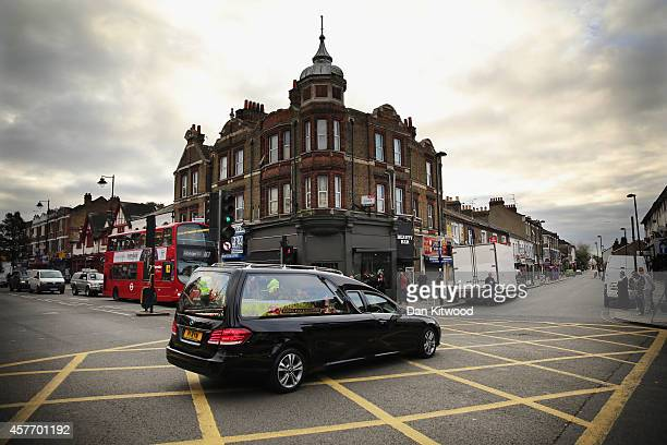 The funeral cortege for murdered teenager Alice Gross passes through Hanwell town centre on October 23 2014 in London England The teenager Alice...