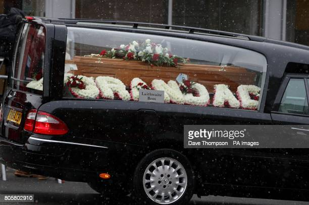 The funeral cortege of Busby Babe Albert Scanlon passes Old Trafford in Manchester