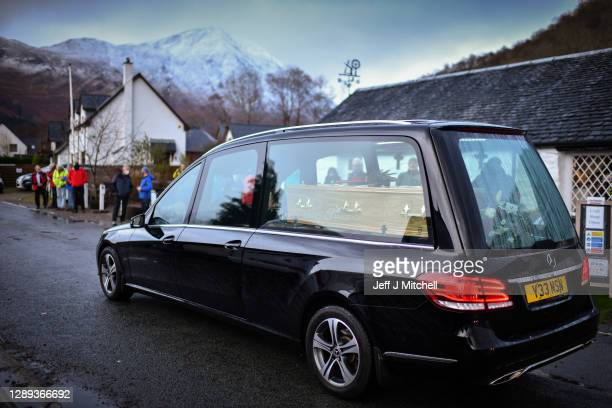 The Funeral cortege of Dr Hamish MacInnes OBE BEM, mountaineer makes its way through Glencoe on December 4, 2020 in Glencoe, Scotland. The climber,...