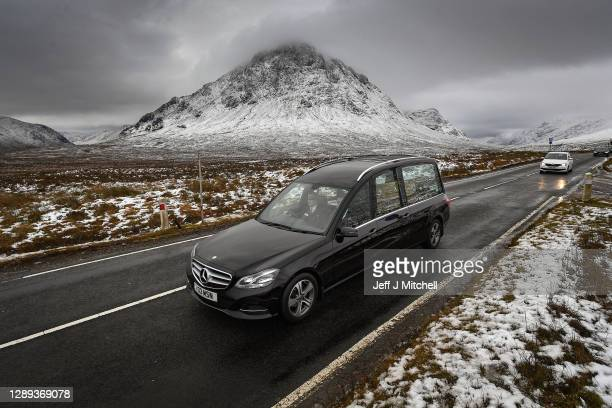 The funeral cortege of Dr Hamish MacInnes OBE BEM, mountaineer makes its way past Buachaille Etive Mor in Glencoe on December 4, 2020 in Glencoe,...